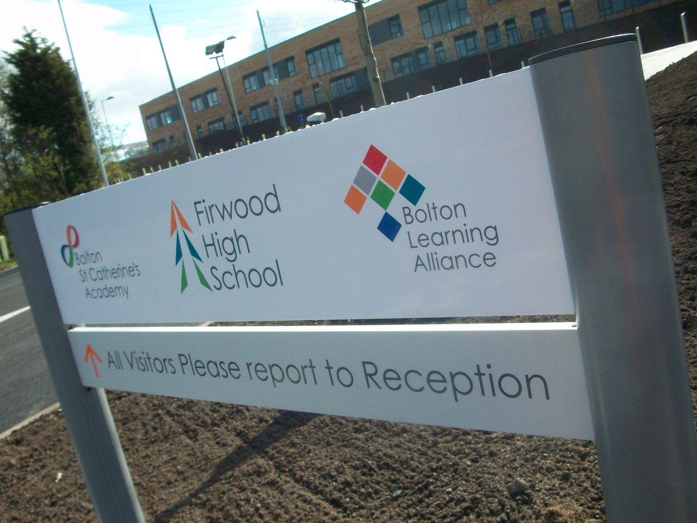 Academy school post sign