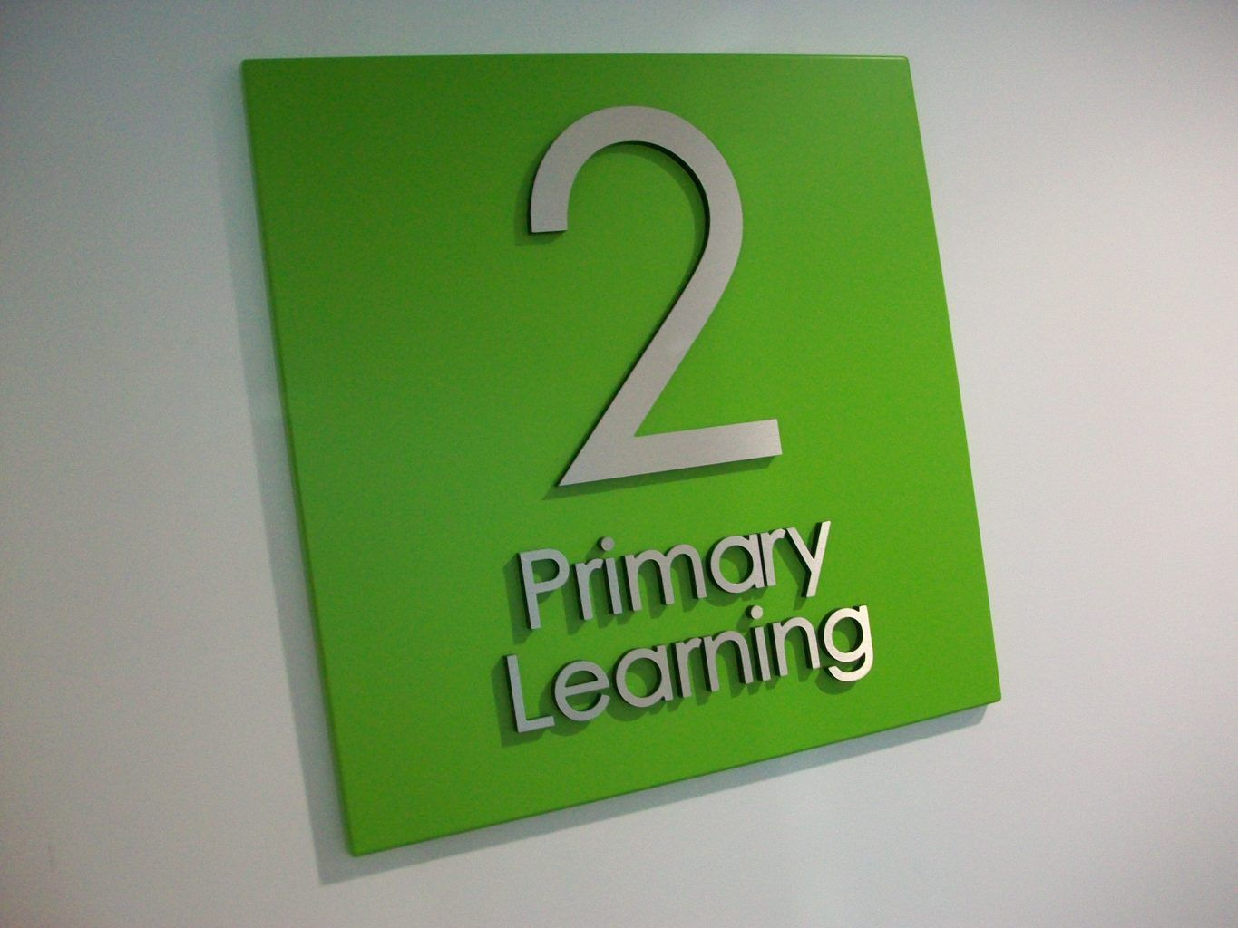 Aluminium Sign tray With brushed stainless steel letters mounted to the face