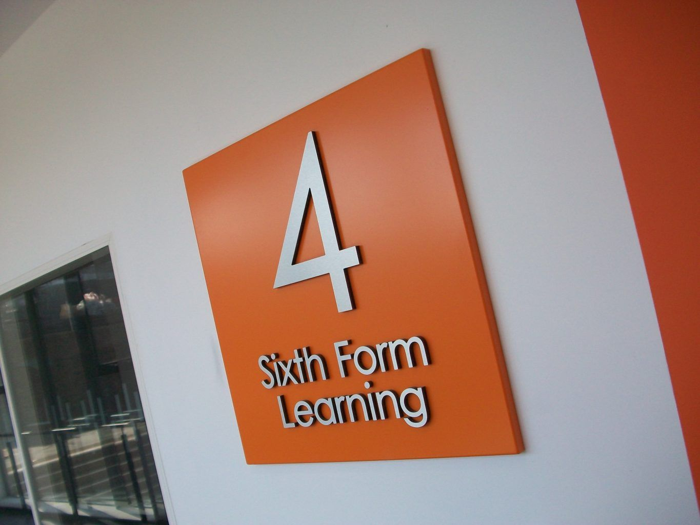 Aluminium tray sign With brushed stainless steel letters mounted to the face