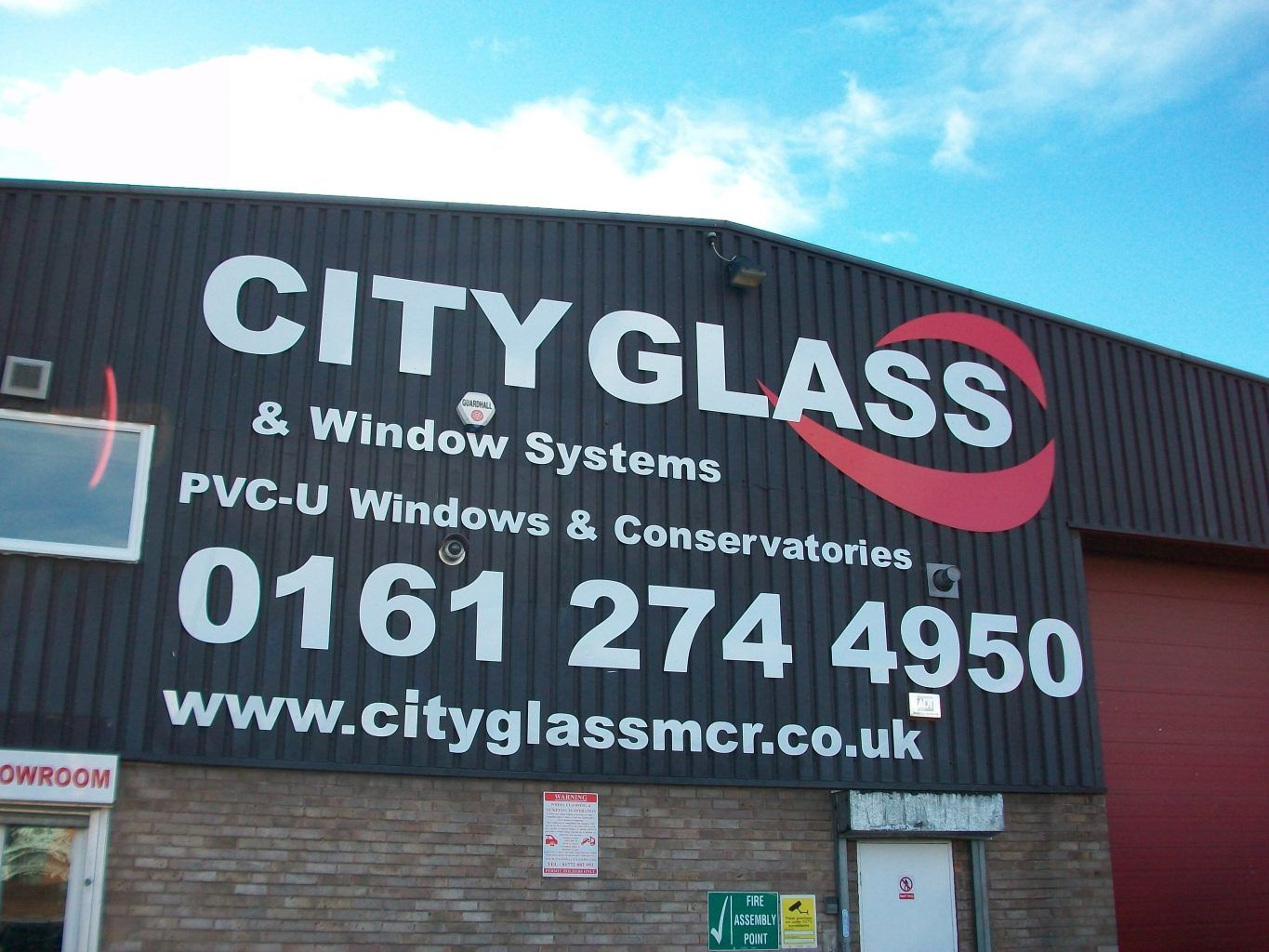 City Glass flat cut letters mounted to cladding