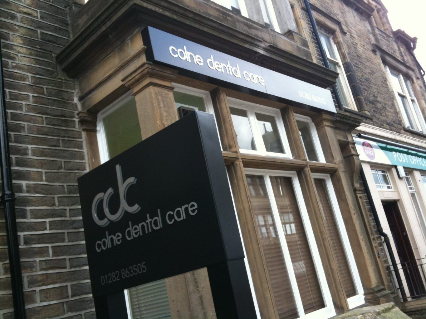 Colne dental Non illuminated sign tray with brushed stainless steel letters bonded to the face