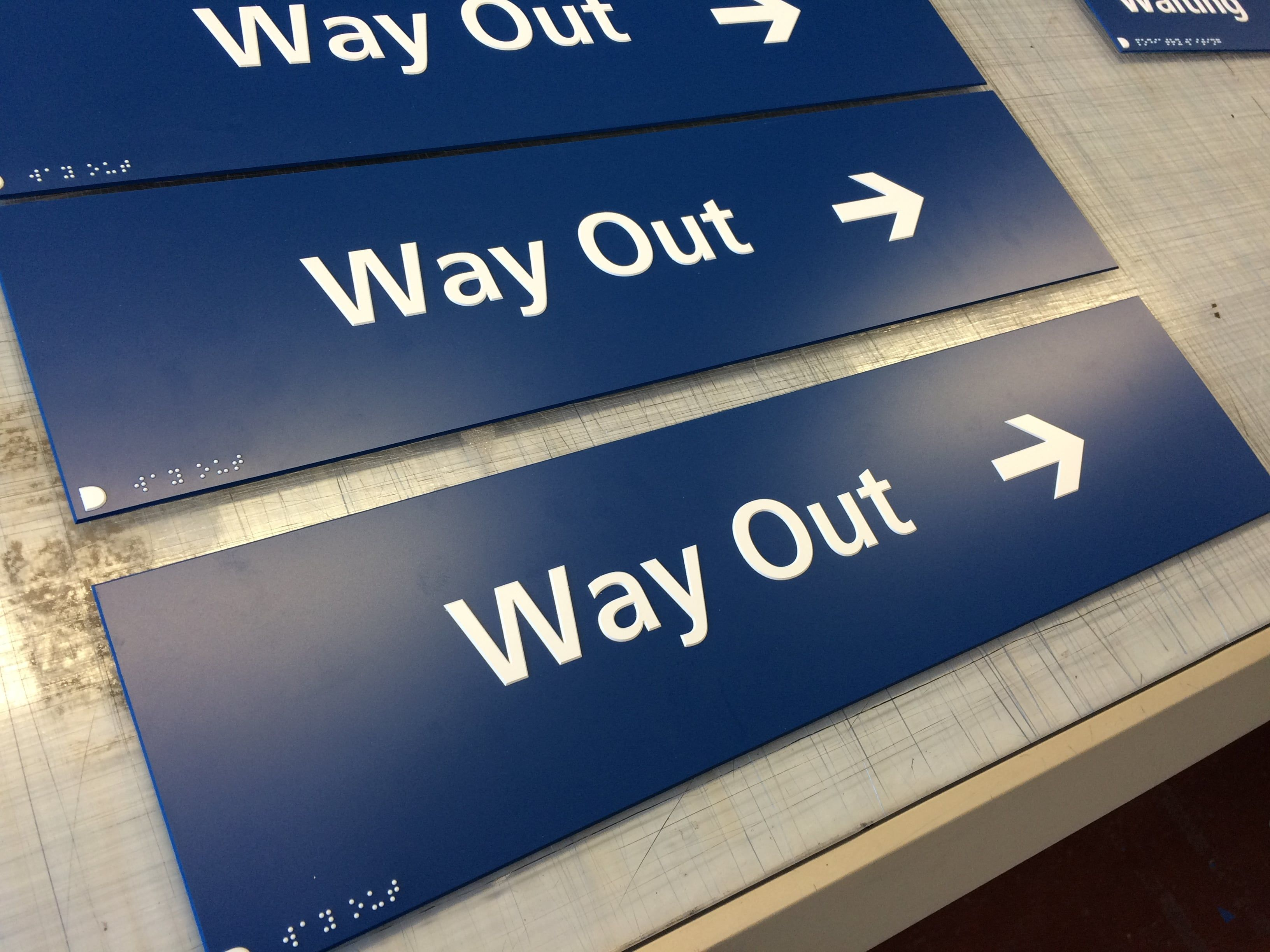NHS WAY OUT BRAILLE & TACTILE SIGNS