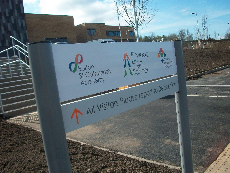 School academy post sign