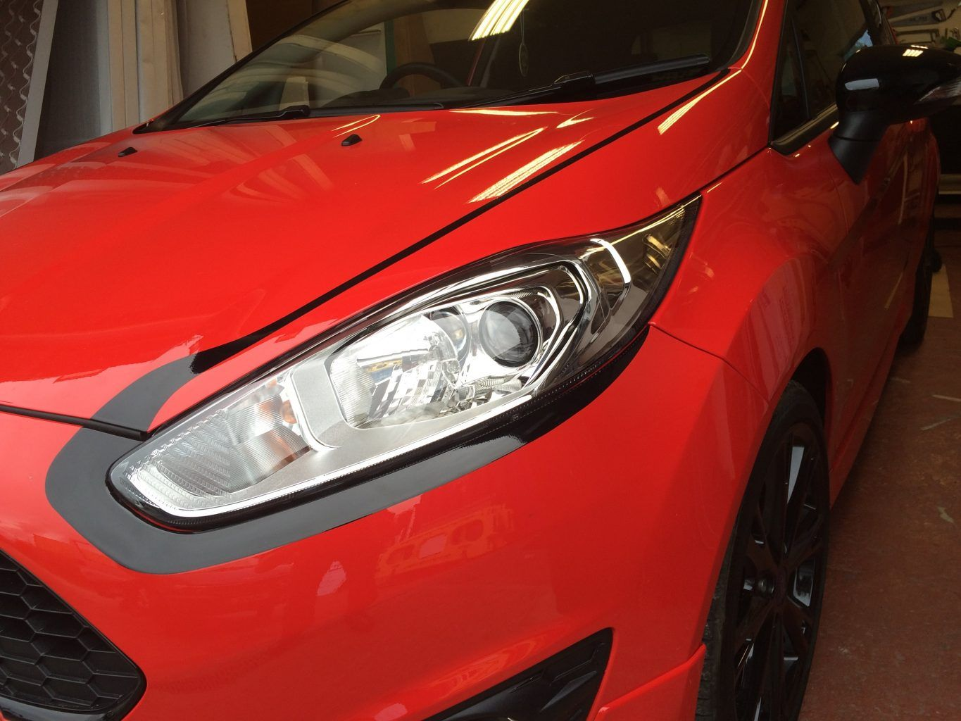 Vehicle wrap headlight detailing